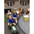 Enjoying riding the bikes in the Wrens playground.