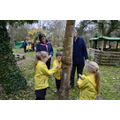 Making clay Gruffalo faces on the trees