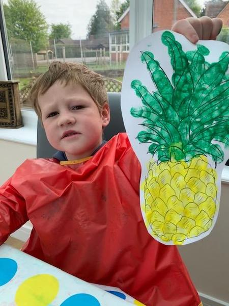 The giraffe stole the pineapple. Great job Archie.