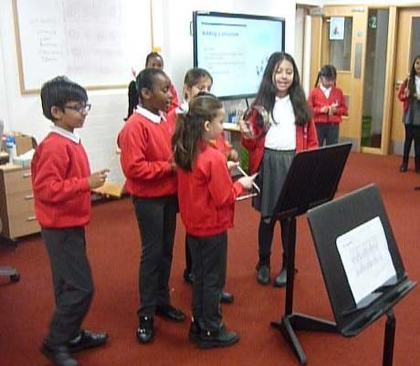 Crimson class performing rhythmic compositions using crotchets, quavers and rests.