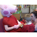 Peppa needed some help to undo the wrapping paper!