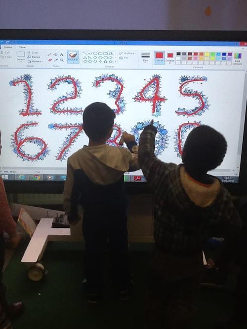 Children writing winter numbers