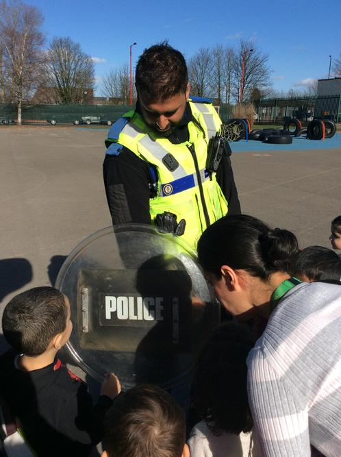 The officer shows us his protective shield