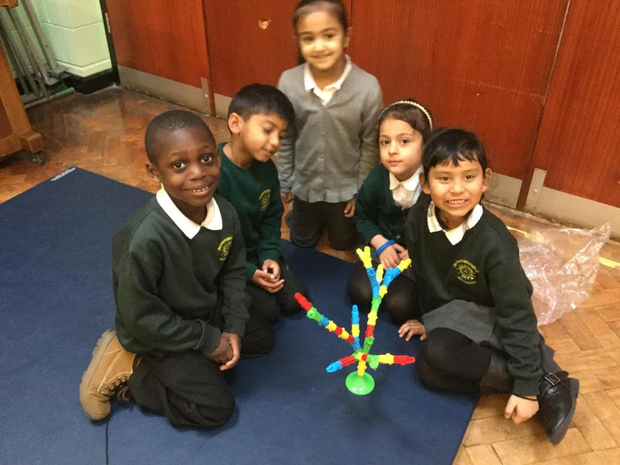 Working together to build a tree.