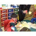 We have been mixing colours in the messy play