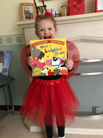 Chloe displaying our key text and dressed as the main character.