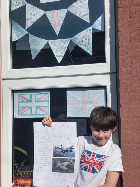 L with his beautiful bunting and newspaper.