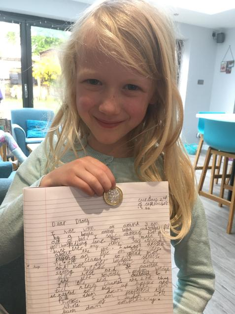 H sharing her diary entry and a special coin