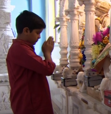 Vraj worshipping at the Mandir