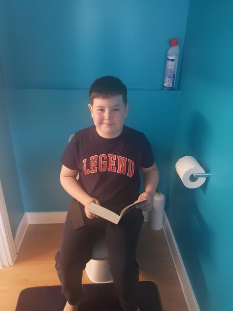 K is LOOsing himself in a good book.
