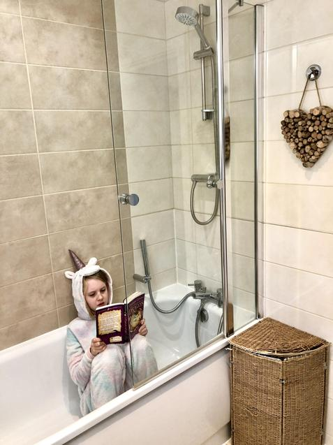 A unicorn in a bath reading!Who would have thought