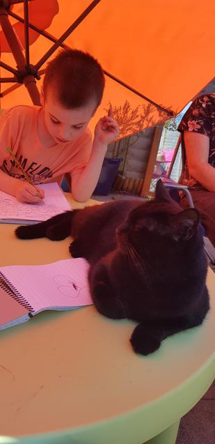 S doing his writing with a friend!