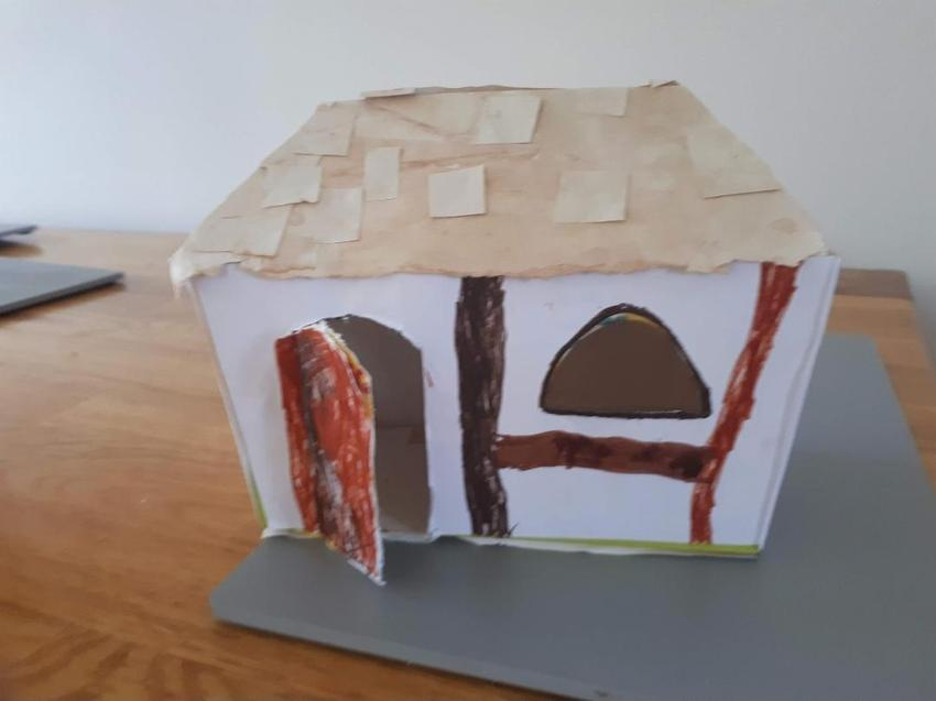 Elise's traditional thatched house.