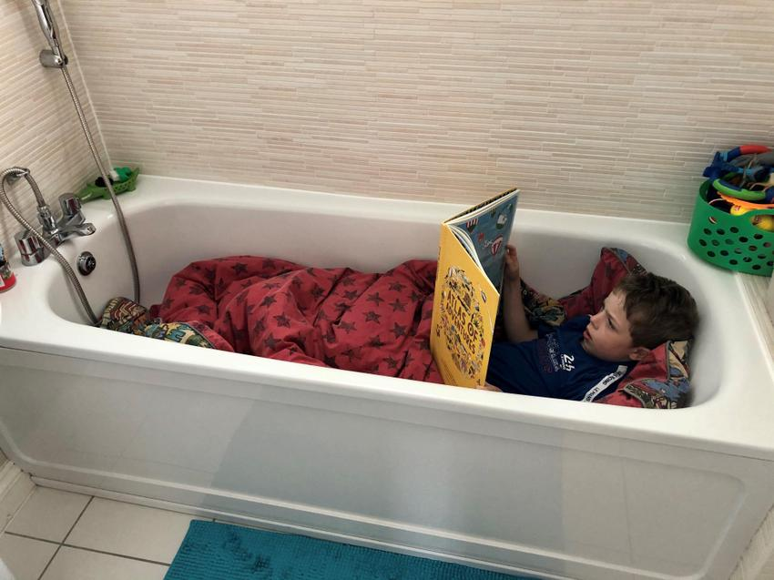 L tucking in for the night with a book