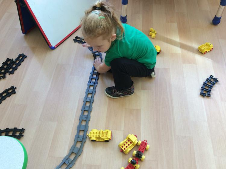 Who can build a train track?