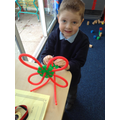 We created a flower with petals, a stem and roots!