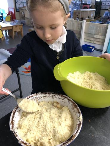 Adding the crumble mix.