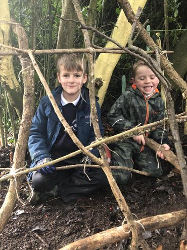 Learning to use rope and string to fix branches together.