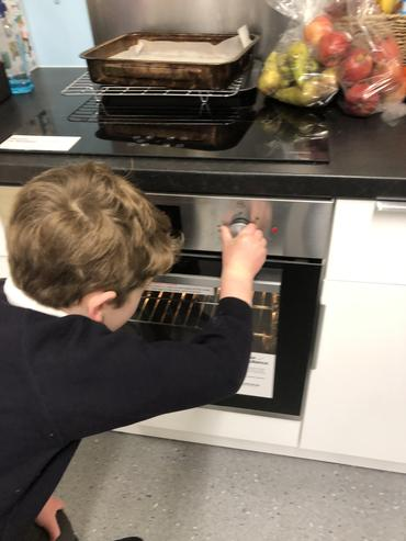 Learning to set the oven temperature.