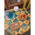 Fresh milk and organic fruit at the snack table.