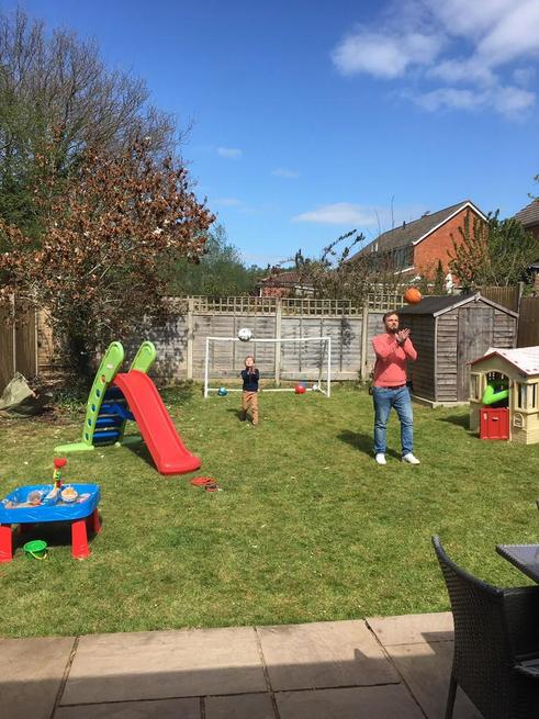 George playing outside in the sunshine with daddy