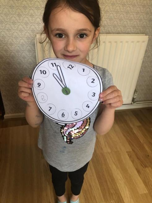 Molly made her own clock and told the time.
