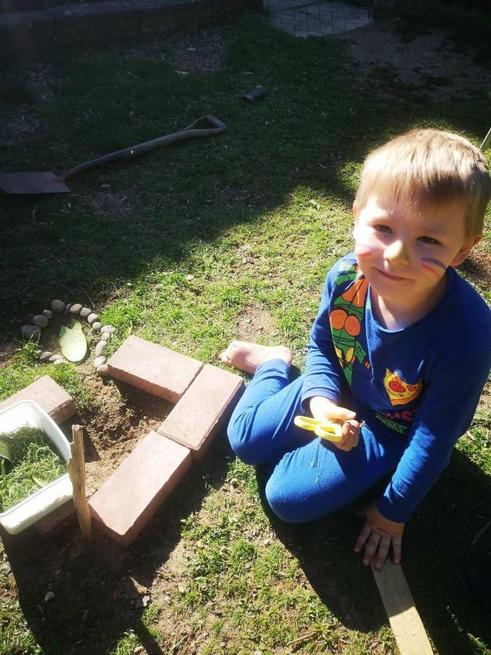 Jacob made a bug den in his garden.