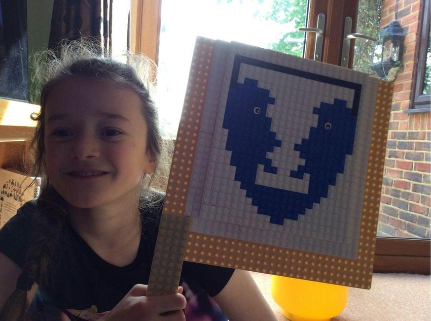 Evie created the school logo out of Lego