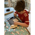 Harrison in the process of tiles making.