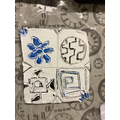 Lily-May's completed tile using patterns inspired by nature and traditional colours.