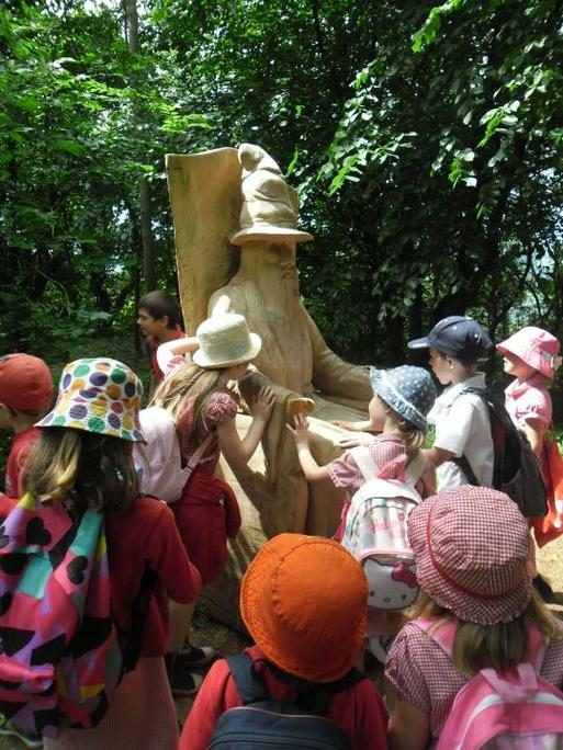 We found lots of sculptures in the woods