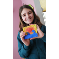 Charlotte's vibrant tile scene using a mixture of applying shapes and imprinting marks.