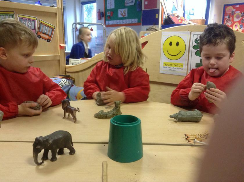 Making clay animals.