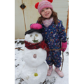 Look at Olivia-Rose and her snowman.