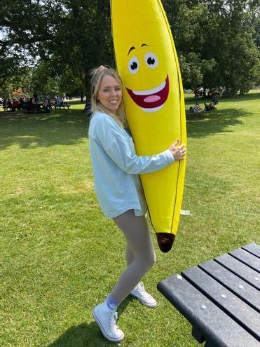 Miss C Gooding with Buddy the class Banana