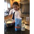 Annabelle making soda bread