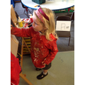 Evie following Isla's painting instructions