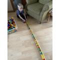 Oscar using a tape measure to measure