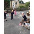 Reception acting out The Three Little Pigs