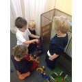 Great team work to make the marble run stay up.