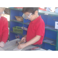 Learning to use the woodwork tools safely.