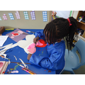 Painting butterflies; making a symmetrical pattern