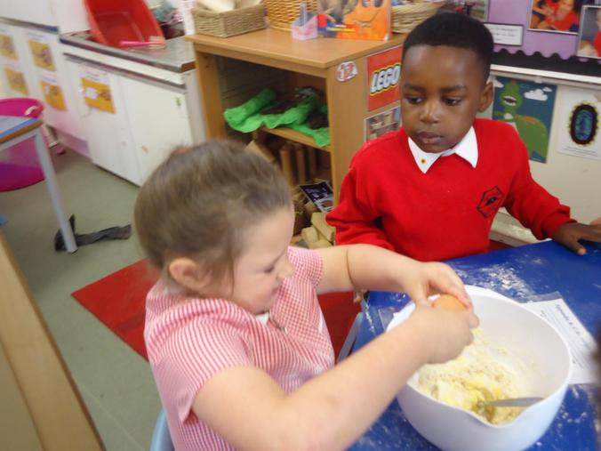 We carefully crack the egg into the mixture!
