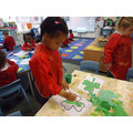 Decorating a shamrock for St Patrick's Day.