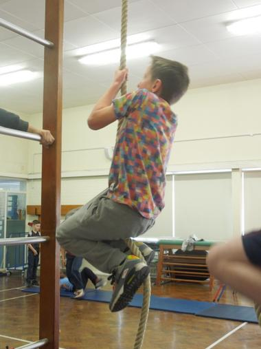 Using upper body strength to climb the rope