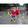 Practising our balancing skills on stilts!