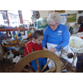 Spinning the wool into yarn.