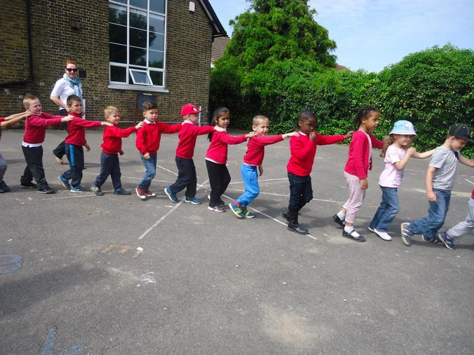 We made a human millipede to walk in the garden.