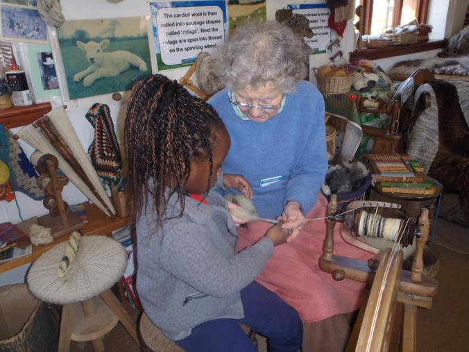 We helped spin the wool into yarn.