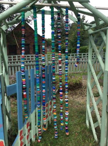The Eco committee worked hard to create a bottle top curtain to begin our sensory garden.